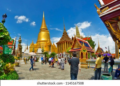 Bangkok, Thailand - October 11, 2014: Visitors entering the Wat Phra Kaew, in the Grand Palace enclosure, first discover the Phra Siratana Chedi and the Phra Mondop.
