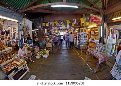 Bangkok, Thailand - October 11, 2014: The bazaar of Tha Tien pier under a wood framework and corrugated sheets.