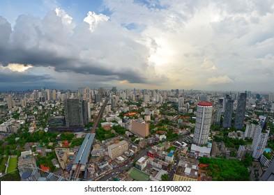Bangkok, Thailand - October 11, 2014: Sunset above Sukhumvit buildings from a rooftop bar.