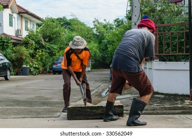 Bangkok, Thailand - October 11, 2015 : Unidentified worker working for drain cleaning. Problem with the drainage system.