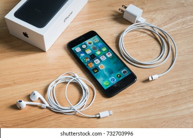 Bangkok, Thailand - October 11, 2017 : Apple iPhone 7 with Earpods, power adapter and the box package.