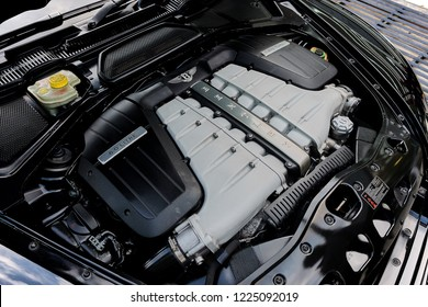 BANGKOK, THAILAND - OCTOBER 11, 2018: Bentley Continental GT engine bay after cleaning & dressing.  6.0 litre, twin-turbocharged W12 engine. Car detailing & modification concept. Luxury car engine.
