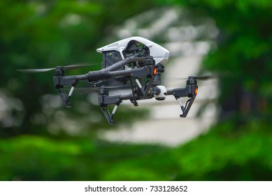 Bangkok Thailand - October 11: the image of DJI Inspire 1 drone quadcopter flying in the sky with green bokeh background on October 11, 2017, in Bangkok Thailand.