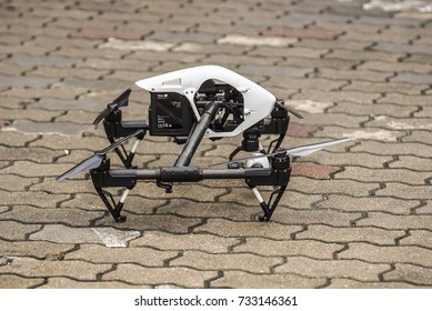 Bangkok Thailand - October 11: image of DJI Inspire 1 drone quadcopter standby on the brick worm floor on October 11, 2017 in Bangkok Thailand.