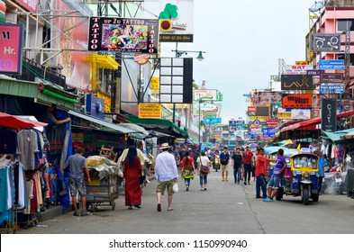 Bangkok, Thailand - October 12, 2014: Khao San Road, the famous backpackers street in Bangkok, with cheap accomodations and a lot of bars, crowded at night with people partying.