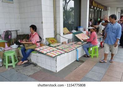 Bangkok, Thailand - October 12, 2014: Lottery tickets vendors on the sidewalk of Ratchadamnoen Klang Road.