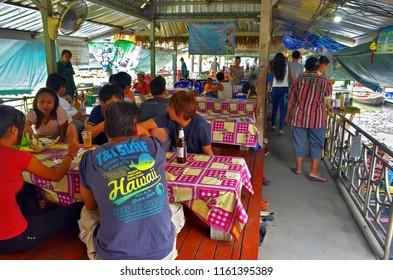 Bangkok, Thailand - October 12, 2014: Restaurant with low tables at Taling Chan Floating Market.