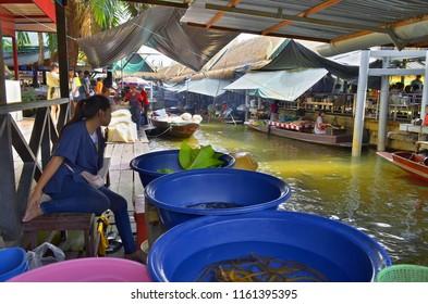 Bangkok, Thailand - October 12, 2014: Thai woman selling elvers along the klong at Taling Chan Floating Market.