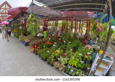 Bangkok, Thailand - October 12, 2014:  Florist stall on the riverbank at Taling Chan Floating Market.