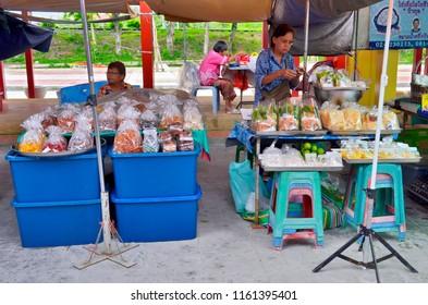 Bangkok, Thailand - October 12, 2014: Food in bags stalls on the riverbank at Taling Chan Floating Market.