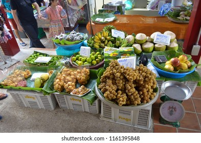 Bangkok, Thailand - October 12, 2014:  Fruit and vegeatble stall on the riverbank at Taling Chan Floating Market.
