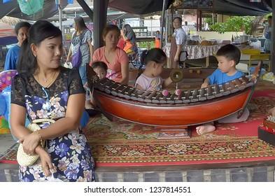 Bangkok, Thailand - October 12, 2014: Thai children plying traditional musical instruments at Taling Chan Floating Market.