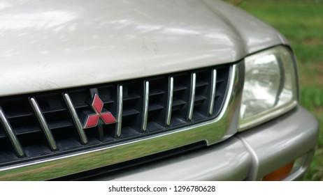 Bangkok Thailand - October 12, 2018: Mitsubishi brand emblem at front grille, Mitsubishi Strada