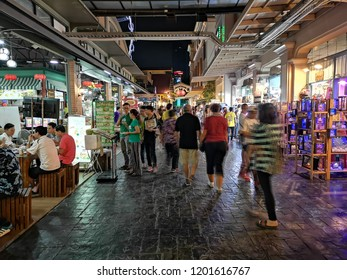 BANGKOK, THAILAND -​ OCTOBER 12,2018:People are traveling and shopping at Asiatique The Riverfront in Bangkok. Asiatique combined two of the most popular shopping experiences a night bazaar and a mall