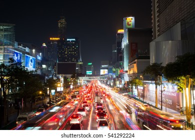 BANGKOK, THAILAND - OCTOBER 13, 2016: View at the Siam square night traffic with light trails. This square is famous shopping area in Bangkok