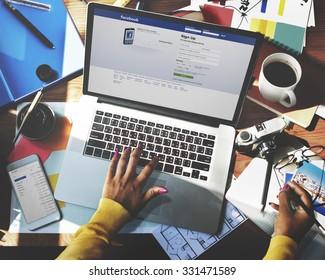 Bangkok, Thailand - October 14, 2015 Woman Using Laptop Browsing Facebook Website