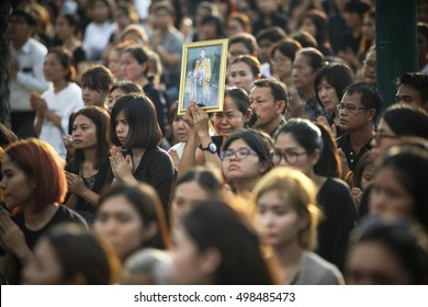 Bangkok, Thailand- October 14, 2016: The women weep while hold the portrait of King Bhumibol Adulyadej during a convoy carrying the body of the King from Siriraj Hospital to the Royal Palace.