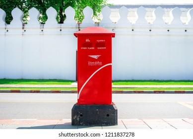 BANGKOK, THAILAND - October 14, 2018 : Thailand red post box on sidewalk with vintage wall at Maharat Road, Rattanakosin Island. Bangkok, Thailand 2018