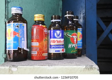 BANGKOK, THAILAND - OCTOBER 14, 2018: the editorial photo of energy drink glass bottles as giant players in consumer market in different colors. Red Bull, Carabao Dang, Lipovitan-D, and Ginseng Power.