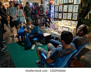 BANGKOK, THAILAND -​ OCTOBER 14,2018:People are traveling and shopping at Asiatique The Riverfront in Bangkok. Asiatique combined two of the most popular shopping experiences a night bazaar and a mall