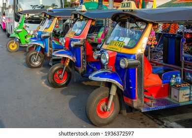 Bangkok, Thailand - October 15, 2014: Famous moto-taxi called tuk-tuk is a landmark of the city and popular transport, Tuk tuk on the street in Bangkok, Thailand.