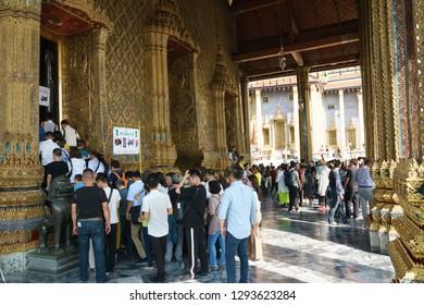 Bangkok, Thailand - October 15, 2018: Tourists stand in row for visiting the temple of Emerald Buddha at Wat Phra Kaew, Bangkok