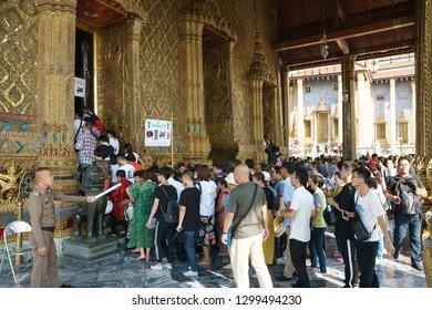 Bangkok, Thailand - October 15, 2018: Tourists stand in row for visiting the Temple of the Emerald Buddha at Wat Phra Kaew, Bangkok
