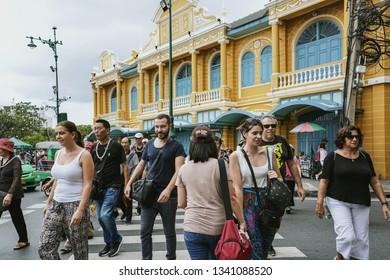 BANGKOK, THAILAND - OCTOBER 15, 2018 : Tourists walking cross the road at Na Phra Lan Road in Bangkok, Thailand.