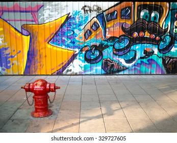 BANGKOK, THAILAND - October 16, 2015: Creative graffiti street art murals are painted on street walls in Ratchadamnoen road on Bangkok, the capital city of Thailand