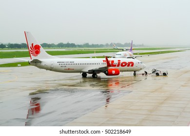 BANGKOK, THAILAND - October 16, 2016: Boeing 737-800 Thai Lion Air parked at Don Mueang International Airport in Bangkok in the raining day, Thailand. the low-cost airline in Thailand .