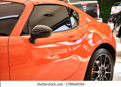 BANGKOK, THAILAND - OCTOBER 16, 2019: car window tint. Ceramic film provide heat & UV protection with black color shade. Automobile film installed to glass surface of car. Professional tinting service