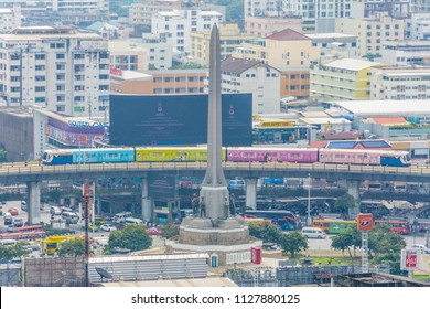 Bangkok, Thailand - October 18, 2016 : Cityscape and Victory Monument with BTS skytrain and traffic in daytime. Victory Monument is a large military monument in Bangkok, Thailand.