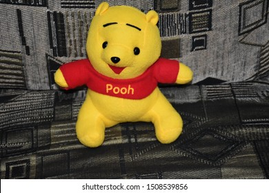 Bangkok, Thailand - October 18, 2018: The doll of the character Winnie the Pooh, Winine the Pooh, is an animation from Disney sitting on the sofa.