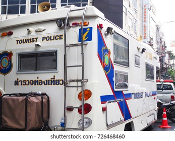 BANGKOK, THAILAND - OCTOBER 2, 2017: Big white van moving office of Tourist Police parking in front of Khaosan Road, in cloudy day