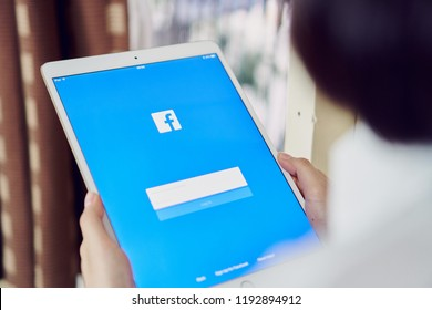 Bangkok, Thailand - October 2, 2018 : hand is pressing the Facebook screen on apple ipad pro,Social media are using for information sharing and networking.