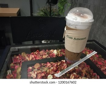 Bangkok, Thailand - October 2 2018 :  ice coffee on the table is in the Cafe Amazon coffee shop which is business unit from PTT Company is in PTT oil and gas station