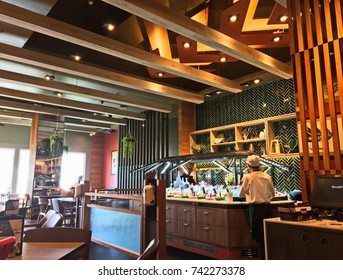 Bangkok, Thailand - October 20, 2017 : Staff is prepared fresh salad for customer at salad bar in Sizzler Restaurant interior. Sizzler is a famous restaurant in Thailand