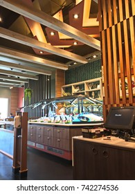Bangkok, Thailand - October 20, 2017 : Vertical garden and dining table in Sizzler Restaurant interior. Sizzler is a famous restaurant in Thailand