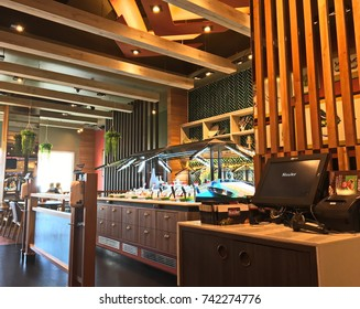 Bangkok, Thailand - October 20, 2017 : Vertical garden and dining table in Sizzler Restaurant interior. Sizzler is a famous restaurant in Thailand