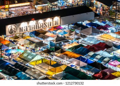Bangkok, Thailand - October 20, 2018 : Beautiful view of colorful tent night market (Ratchada) in Bangkok city downtown. Aerial view of outdoor flea market.