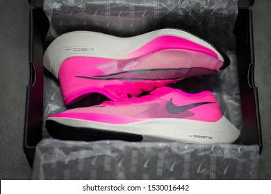 """Bangkok / Thailand - October 2019 : Nike launch """"ZoomX Vaporfly Next%"""" in new pink color. This is elite class running shoe weared by Eliud Kipchoge and his team to break record in INEOS project."""