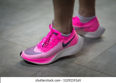 """Bangkok /Thailand - October 2019 : A runner is wearing Nike """"ZoomX Vaporfly Next%"""" in pink. This is new elite class running shoe weared by Eliud Kipchoge and his team to break record in INEOS project."""