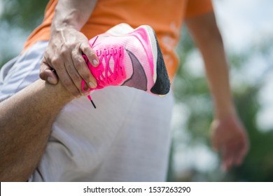"""Bangkok /Thailand - October 2019 : A runner warming up with Nike """"ZoomX Vaporfly Next%"""". The shoe is elite class which is weared by Eliud Kipchoge and his team to break record in INEOS project."""