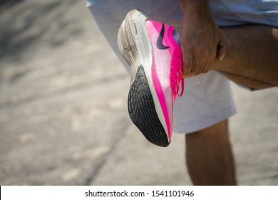 """Bangkok /Thailand - October 2019 : A runner warming up with Nike """"ZoomX Vaporfly Next%"""". This shoe is elite class which is weared by Eliud Kipchoge and his team to break record in INEOS project."""