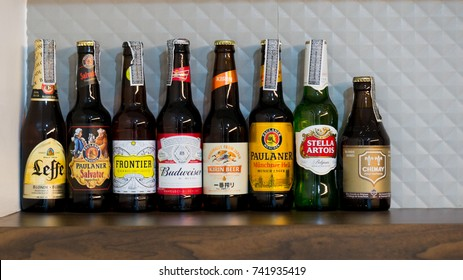 Bangkok, Thailand - October 20th, 2017 ; many kinds or brands of beers were on the wooden shelf over the beverage bar of the house near Don Muang Airport