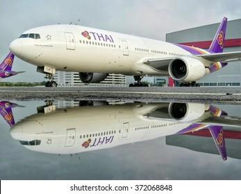 Bangkok Thailand October 21 2014:Thai Airways Boeing 777-200 (HS-TJF) parking in front of hangar after rain at Suvanabhumi International Airport.