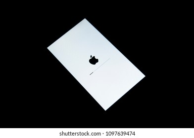 BANGKOK, THAILAND - OCTOBER 21, 2017: A screen of an iPhone updating software isolated on black background