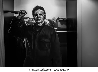 Bangkok, Thailand – October 21, 2018: Recreation of a scene from the 1978 movie Halloween; Michael Myers (the shape) holding a knife Displays at the Theater.