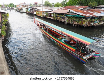 Bangkok, Thailand - October 22, 2018: Landscape of the traditional way of life of Thai people living near the river and boat tourism at Thailand