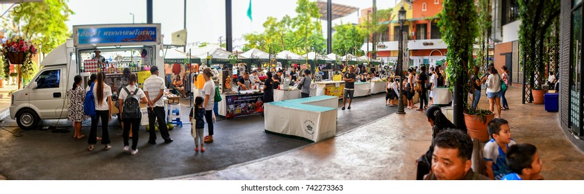 BANGKOK, THAILAND - OCTOBER 22: Stalls and a food truck conduct business in the parking lot of Victoria Gardens in Bangkok on October 22, 2017.